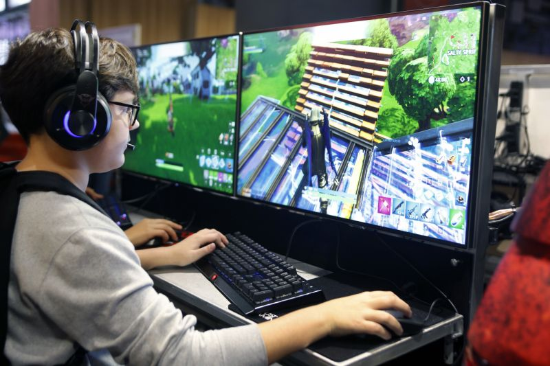 PARIS, FRANCE - OCTOBER 26: A gamer plays the video game 'Fortnite Battle Royale' developed by Epic Games during the 'Paris Games Week' on October 26, 2018 in Paris, France. 'Paris Games Week' is an international trade fair for video games and runs from October 26 to 31, 2018. (Photo by Chesnot/Getty Images)