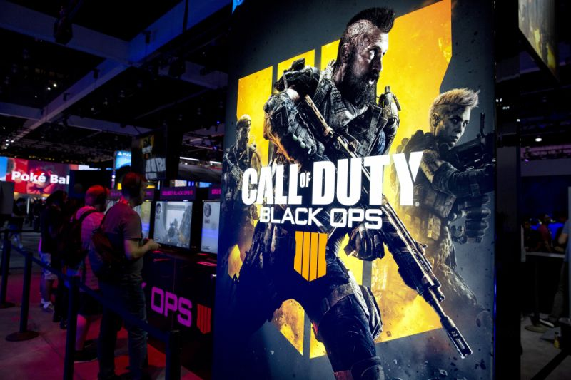 Attendees play the Activision Blizzard Inc. Call Of Duty: Black Ops 4 video game at the company's booth during the E3 Electronic Entertainment Expo in Los Angeles, California, U.S., on Tuesday, June 12, 2018. For three days, leading-edge companies, groundbreaking new technologies and never-before-seen products is showcased at E3. Photographer: Troy Harvey/Bloomberg via Getty Images