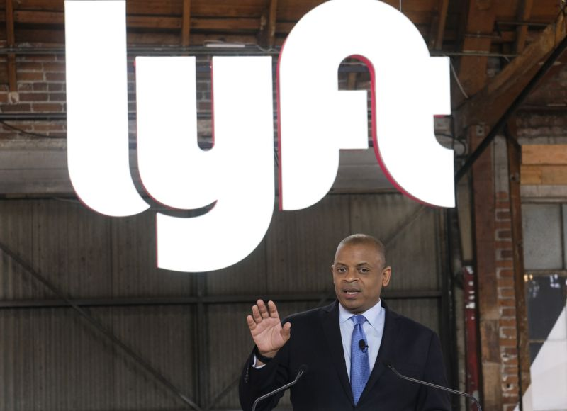 """Anthony Foxx, chief policy officer of Lyft Inc., speak during a ceremonial opening bell in Los Angeles, Friday, March 29, 2019. On Friday the San Francisco company's stock will begin trading on the Nasdaq exchange under the ticker symbol """"LYFT."""" (AP Photo/Ringo H.W. Chiu)"""