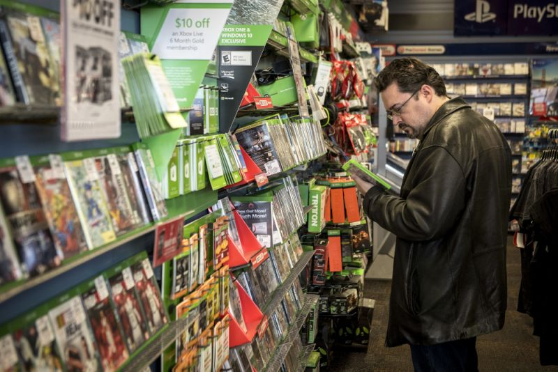 A customer browses merchandise at a GameStop Corp. store in Chicago, Illinois, U.S., on Sunday, Nov. 20, 2016. GameStop Corp. is scheduled to release earnings figures on November 22. Photographer: Christopher Dilts/Bloomberg via Getty Images