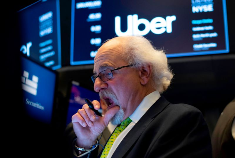 Traders work after the opening bell during the IPO of the ride sharing company Uber, at the New York Stock Exchange (NYSE) on May 10, 2019, in New York. (Photo by Johannes EISELE / AFP) (Photo credit should read JOHANNES EISELE/AFP/Getty Images)