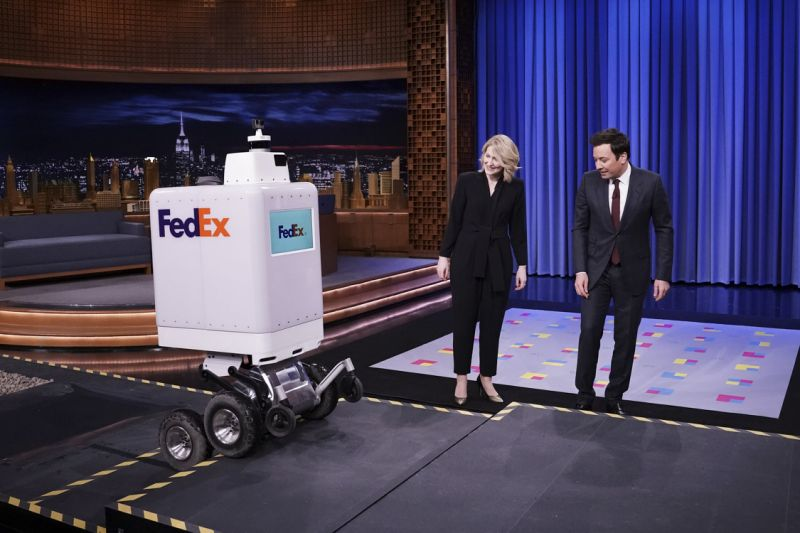"THE TONIGHT SHOW STARRING JIMMY FALLON -- Episode 1023 -- Pictured: (l-r) A FedEx delivery Robot, FedEx representative Bree Carere, and host Jimmy Fallon during ""Tonight Showbotics"" on February 26, 2019 -- (Photo by: Andrew Lipovsky/NBC/NBCU Photo Bank via Getty Images)"