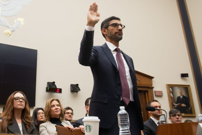 """Google CEO Sundar Pichai is sworn in as he testifies during a House Judiciary Committee hearing on Capitol Hill in Washington, DC, December 11, 2018. - Google chief executive Sundar Pichai will be grilled by US lawmakers over allegations of """"political bias"""" by the internet giant, concerns over data security and its domination of internet search. (Photo by SAUL LOEB / AFP) (Photo credit should read SAUL LOEB/AFP/Getty Images)"""