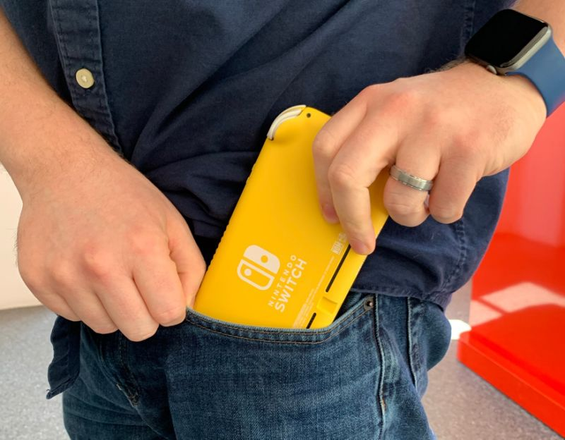 The Nintendo Switch Lite easily slides into my jeans pocket. (Image: Howley)