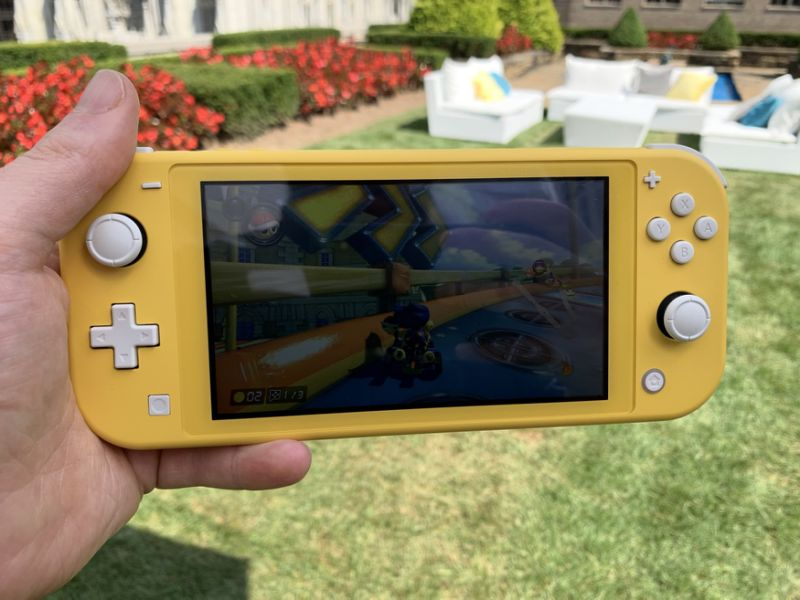 The Switch Lite is definitely more portable, but that doesn't mean you should play it in direct sunlight. (Image: Howley)
