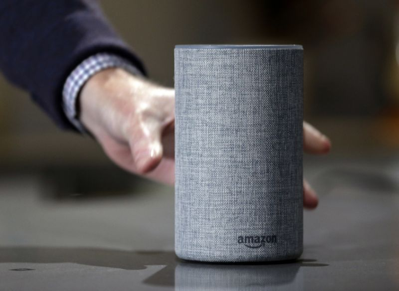 "FILE - In this Sept. 27, 2017, file photo, a new Amazon Echo is displayed during a program announcing several new Amazon products by the company, in Seattle. Big Mouth Billy Bass is programmed to respond to Alexa voice commands through a compatible Amazon Echo device. That means the singing and talking fish will lip synch to Alexa's responses and will dance to songs from Amazon music. When it's first plugged in, it will respond ""Woo-hoo, that feels good!"" (AP Photo/Elaine Thompson, File)"