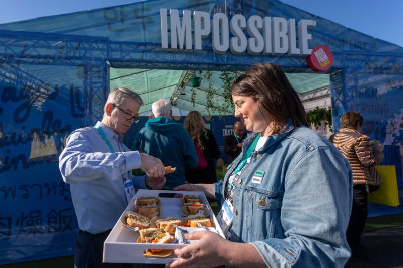 A woman serves Impossible Pork, a new plant-based pork product by Impossible Foods, at the 2020 Consumer Electronics Show (CES) in Las Vegas, Nevada on January 9, 2020. - CES is one of the largest tech shows on the planet, showcasing more than 4,500 exhibiting companies representing the entire consumer technology ecosystem. (Photo by DAVID MCNEW / AFP) (Photo by DAVID MCNEW/AFP via Getty Images)