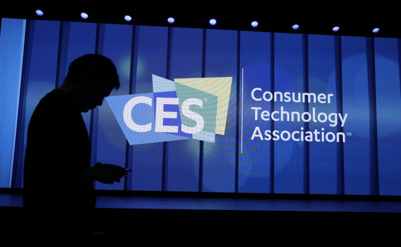 A person walks past a sign at a Samsung keynote before the CES tech show, Monday, Jan. 6, 2020, in Las Vegas. (AP Photo/John Locher)